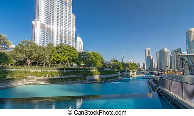 Evening view of cascade of water near dancing fountains in downtown timelapse in Dubai, UAE.