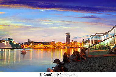 evening view of embankment from Port Vell in sunset. Barcelona, Catalonia