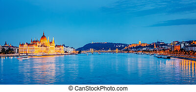 Evening view of Hungarian Parliament and Budavari Palota with Margit bridge. Popular tourist attraction. Dramatic and picturesque scene. Famous location place Budapest, Hungary, Europe. Beauty world.
