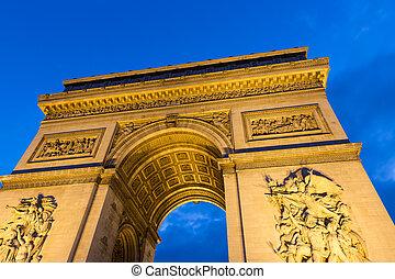 Evening view of Illuminated Arc de Triomphe in Paris