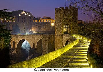 evening view of medieval bridge at Besalu. Catalonia, Spain