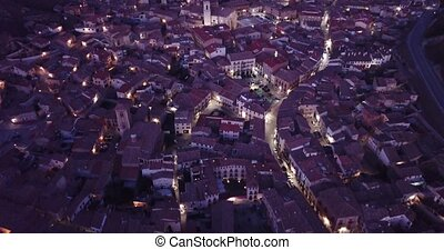 Evening aerial view of medieval Spanish town of Daroca with illuminated Basilica of St. Mary of Sacred Body