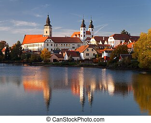 Evening view of Telc or Teltsch town mirroring in lake