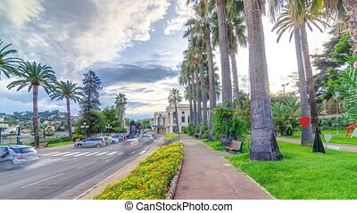 Evening view to palms on the center street of...
