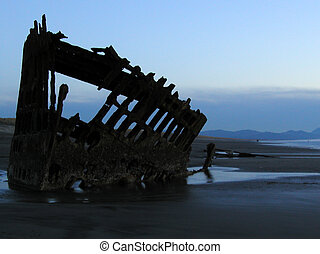 Evening Wreck 1 - The wreck of the Peter Iredale silhouetted...