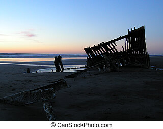 Evening Wreck 3 - The wreck of the Peter Iredale silhouetted...