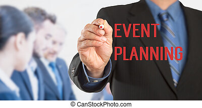Event planning, business man writing, team in background