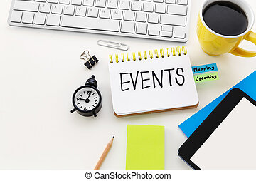 Event planning with clock notepad and coffee cup on computer...