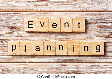 Event planning word written on wood block. Event planning text on table, concept