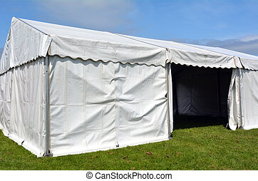 Event tent - Empty event tent in a fair outdoor on green...