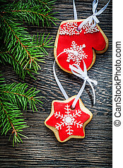 Evergreen tree branch Christmas cookie on wooden board