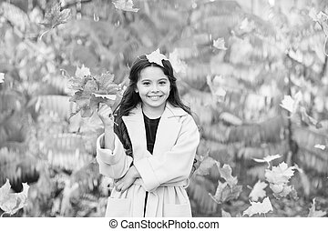 Every girl loves to be stylish. Little girl happy smiling with autumn leaves. Little fashionista in stylish wear. Happy girl on autumn day. I feel comfortable and stylish