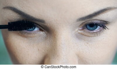 Everyday Makeup - Extreme close up of female face while her...