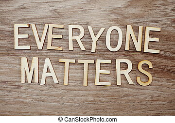everyone matters letters on wooden background business concept for equality respect