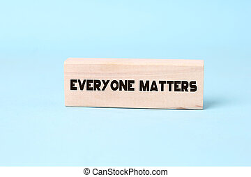 Everyone matters - phrase words from wooden blocks with letters, accepting others individuality everyone matters concept, top view