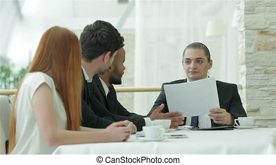 Everyone turns when the boss comes - Smiling businessman in...