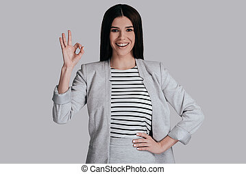 Everything is great! Beautiful young woman in smart casual...