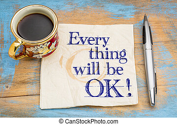 Everything will be OK! Handwriting on a napkin with a cup of...