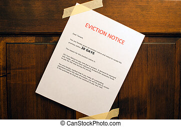 Eviction Notice - An eviction notice taped to a door.
