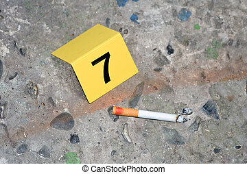 Evidence at a fresh crime scene: ash, a cigarette with...