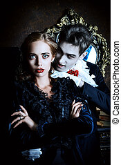 evil fear - Bloodthirsty male vampire in medieval dress is...