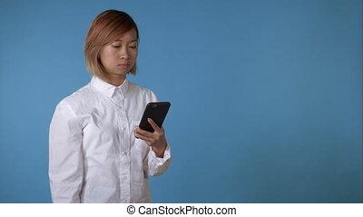 evil girl using smartphone