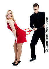 Evil guy poking sensual woman in red. all on white background
