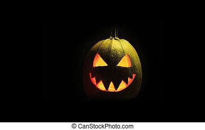 Evil Halloween pumpkin head on a dark background
