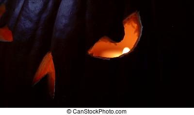 Evil Jack O'Lantern Eye - Spooky close up of jack o' lantern...
