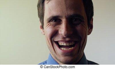 Evil laughing of a genius - Man sinister laugh in adark
