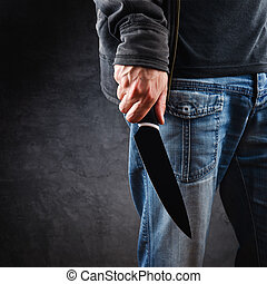 Evil man hold shiny knife, killer in action - Evil man with...