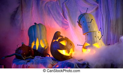 Evil pumpkin in night light glow, vapor or mist flowing around. Traditional attributes of the All Saints' Day or Halloween