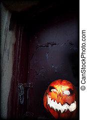 Evil Pumpkin - Jack O Lantern in front of Old Door