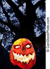 Evil Pumpkin - Jack O Lantern with Dark Tree and Houses