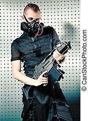 evil - Shot of a conceptual man in a respirator holding a...