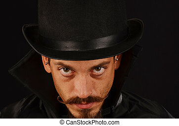 Man with top hat black cape
