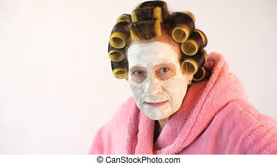 Evil wife with a cosmetic mask and curlers - Evil terrible...