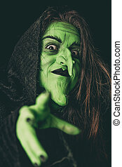 Evil witch casting a curse - Green witch acting like she is...