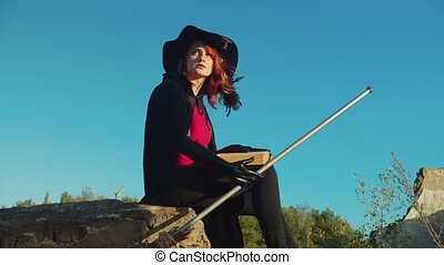 Evil witch with spellbook conjuring at sunset - Evil ...