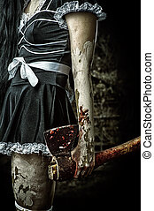 evil woman holding a bloody ax - Horror. Dirty woman's hand...