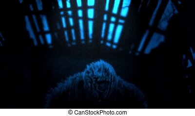 Evil zombie screams inside barn. Blue color. Genre of horror...