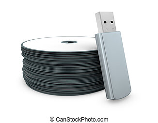 evolution of data storage - one usb key with a stack of cd...