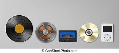 Evolution of technology concept, vinyl record, tape, disk and mp3 player on the grey background.