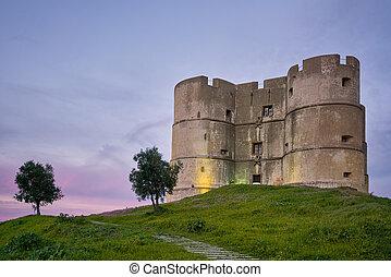 Evoramonte city castle at sunset in Alentejo, Portugal