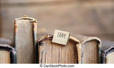 Exam concept, retro style, books and tag
