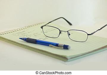 Exam - Notebook, pen and Specs