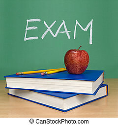 Exam written on a chalkboard. Books, pencils and an apple on...