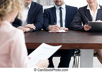 Examination board making notes
