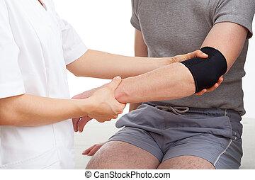 Examination of elbow - Examination of injured elbow of...