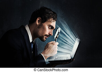 Examine a computer - Businessman look with magnifying glass...